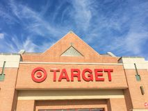 Entrance to Target the second-largest discount store retailer in. IRVING, TX, US-APR 17, 2018:Close-up logo sign Target entrance cloud blue sky. Second-largest Stock Photos