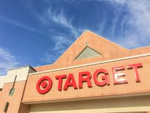 Entrance to Target the second-largest discount store retailer in. IRVING, TX, US-APR 17, 2018:Close-up logo sign Target entrance cloud blue sky. Second-largest Royalty Free Stock Image