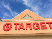 Entrance to Target the second-largest discount store retailer in. IRVING, TX, US-APR 17, 2018:Close-up logo sign Target entrance cloud blue sky. Second-largest stock photography