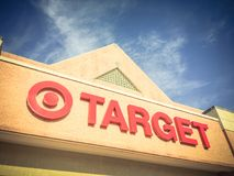 Entrance to Target the second-largest discount store retailer in. IRVING, TX, US-APR 17, 2018:Vintage close-up logo sign Target entrance cloud blue sky. Second stock photo