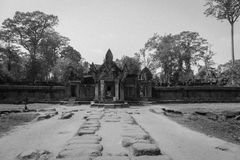 Entrance to a temple at the Angkor Wat Ruins. Black and white image of a stone road to the entrance of a temple at the Angkor Wat historic ruins complex near Royalty Free Stock Photo