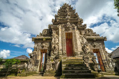 Entrance to temple in Bali. BALI, INDONESIA - 19TH JUNE 2015; One  of the entrance to small  temple in district Ubud during the religious ceremony on June 19 Royalty Free Stock Photo