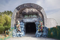 Entrance to the Ten Courts of Hell. SINGAPORE - FEBRUARY 1, 2014: Entrance to the Ten Courts of Hell with Ox-Head and Horse-Face Guradians at Haw Par Villa Theme Stock Image