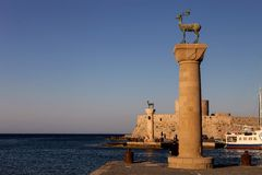 Entrance To The Harbor Of Rhodes, Greece, Behind A Pillar And Tower