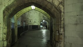 Entrance to the Tower of London by night stock footage