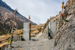 Entrance to traditional Nepali village - Khangsar. Stock Images