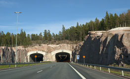 The entrance to the tunnel on the motorway Turku-Helsinki. Finland. The entrance to the tunnel on the motorway Turku-Helsinki summer day. Finland stock photography