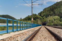 Entrance to the tunnel on the railway bridge. Traveling by train across Europe. Royalty Free Stock Photography