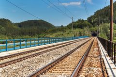 Entrance to the tunnel on the railway bridge. Traveling by train across Europe. Stock Image