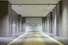 Entrance to underground garage. Illuminated entrance door to underground garage Royalty Free Stock Photo