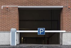 Entrance to the underground parking, barrier, parking sign Stock Photos