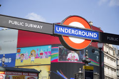 Entrance to underground on Piccadilly circus with large screen i Royalty Free Stock Photo