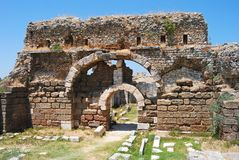 Entrance to the vast Baths of Faustina in Miletus. Stock Images