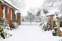 Driveway to rural house in snow royalty free stock photography