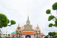 Entrance to Wat Arun buddhist temple,Wat Arun Ratchawararam or the Temple of Dawn. Thailand iconic decorated by ceramics ,Giant st Royalty Free Stock Image