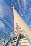 Entrance to windmill with wind turbine Stock Images