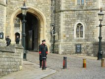 The entrance to Windsor Castle in Windsor Berkshire. Armed police and warden outside windsor castle entrance.the castle is in windsor berkshire england Royalty Free Stock Photo