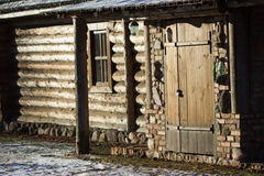 Entrance to the wooden house built of logs. Royalty Free Stock Photography