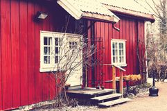 The entrance to the wooden red building. Christmas decorations on it. Building in an old foundry in Baerum Verk. Vintage look from HDR photo. Norwegian winter Stock Image