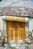 Entrance to the yurt. Wooden door entrance to the yurt, a traditional nomad house Royalty Free Stock Photos