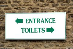 Entrance and toilets sign Stock Image