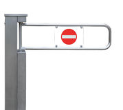 Entrance tourniquet, detailed turnstile, stainless steel, red no entry sign, isolated closeup, access control concept Royalty Free Stock Photography