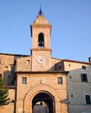 Medieval village of Staffolo in central Italy. Entrance tower in the historic center of the medieval village of Staffolo and bell tower of the Church of San stock image