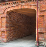 Entrance tunnel of old brick. Dark arch. Stock Images