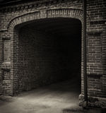 Entrance tunnel of old brick. Dark arch. Black white. Entrance tunnel of old brick. Dark arched doorway. Black-white Stock Photography