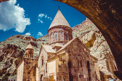 Entrance through tunnel to cave monastery Geghard, Armenia. Armenian architecture. Pilgrimage place. Religion background. Travel c Stock Images