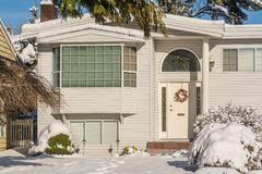 Entrance of typical american house in winter. Snow covered house. Entrance of typical american house in winter. Entrance of average house decorated for holiday royalty free stock images
