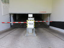Entrance of an underground parking garage. The entrance of an underground parking garage with closed barriers Royalty Free Stock Image