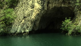 Entrance underground river cave stock video footage