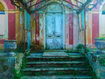 Rundown building in Corfu. Exterior of a rundown building with overgrown steps in the foreground, Corfu, Greece Stock Photo