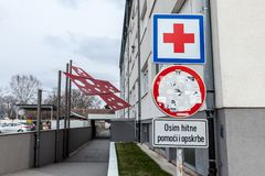 Entrance of the Vukovar Hospital memorial with its iconic red cross, a memorial dedicated to the massacre that occured there. Picture of the memorial in the Stock Photo