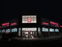 Entrance of Walgreens store with lighted signs in Edison, NJ USA. Stock Image