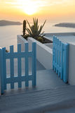 Entrance of white house and sunset in town of Imerovigli, Santorini island, Thira, Greece Stock Image