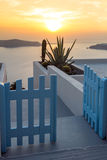 Entrance of white house and sunset in town of Imerovigli, Santorini island, Thira, Greece Royalty Free Stock Photos