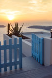 Entrance of white house and sunset in town of Imerovigli, Santorini island, Thira, Greece Stock Images