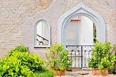 Entrance and window in a stone wall Royalty Free Stock Photos