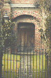 Entrance wooden door and metal gate of a traditional English man Stock Images