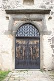 Entrance wooden gate to the castle with knockers royalty free stock photography