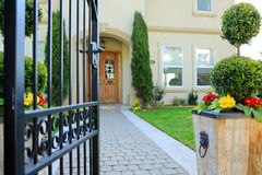 Entrance wrought iron gate to luxury house Stock Images