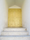 Entrance is yellow door and a marble staircase in the ancient temple of Thailand Stock Photography