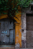 Entrance of yellow old colonial building with wood Royalty Free Stock Photos