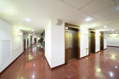 Entrances to elevators and marble floor. In big stylish hotel vector illustration