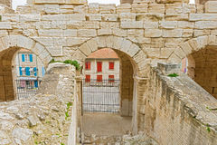 On of the entrances to Roman amphiteathre in Arles, France. Stock Images