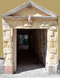 Entranceway on Perth High Street, Scotland, dated 1699. A sandstone entrance to a vennel (alleyway) on Perth High Street with initials of the original owners and royalty free stock photography
