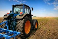 Entraîneur - matériel moderne d'agriculture Images libres de droits