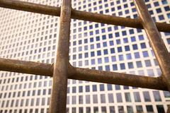 Entrapped in office. An office building and bars Stock Photo